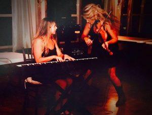 Fiddlin and playin like RockStars!  Sarah Michelle Bell & Michelle Bell